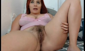 Hairy babe teasing on webcam